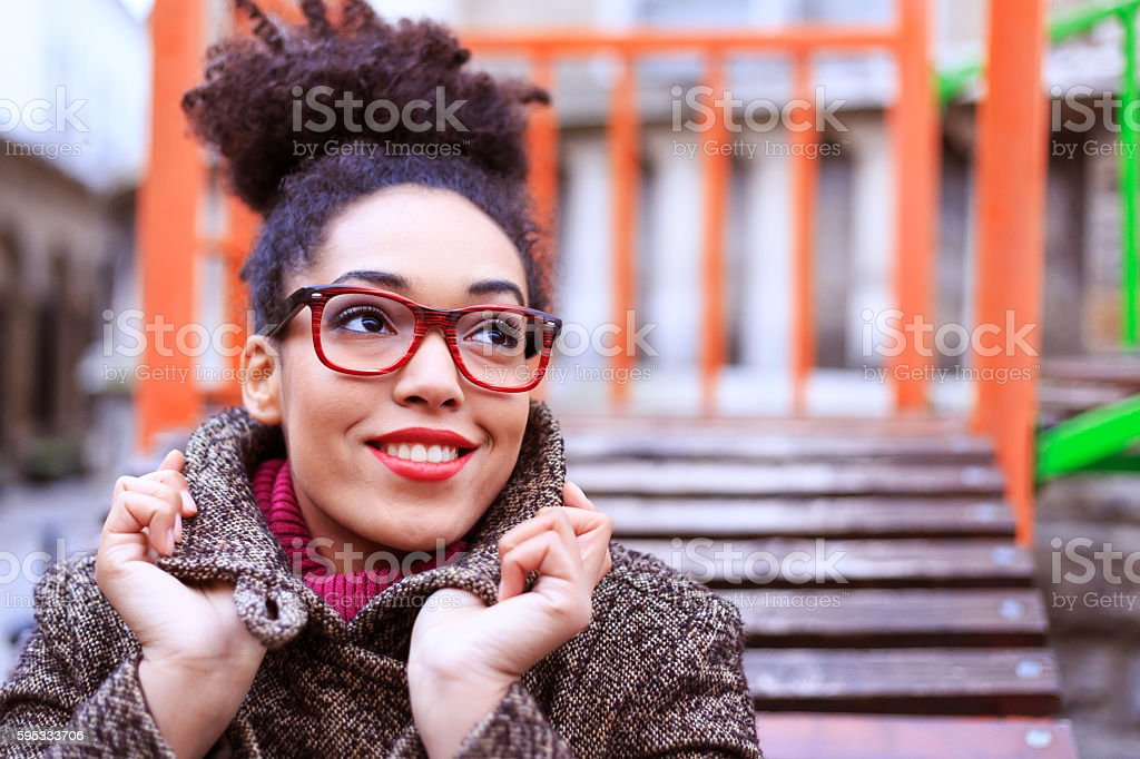 Young woman standing on street stock photo