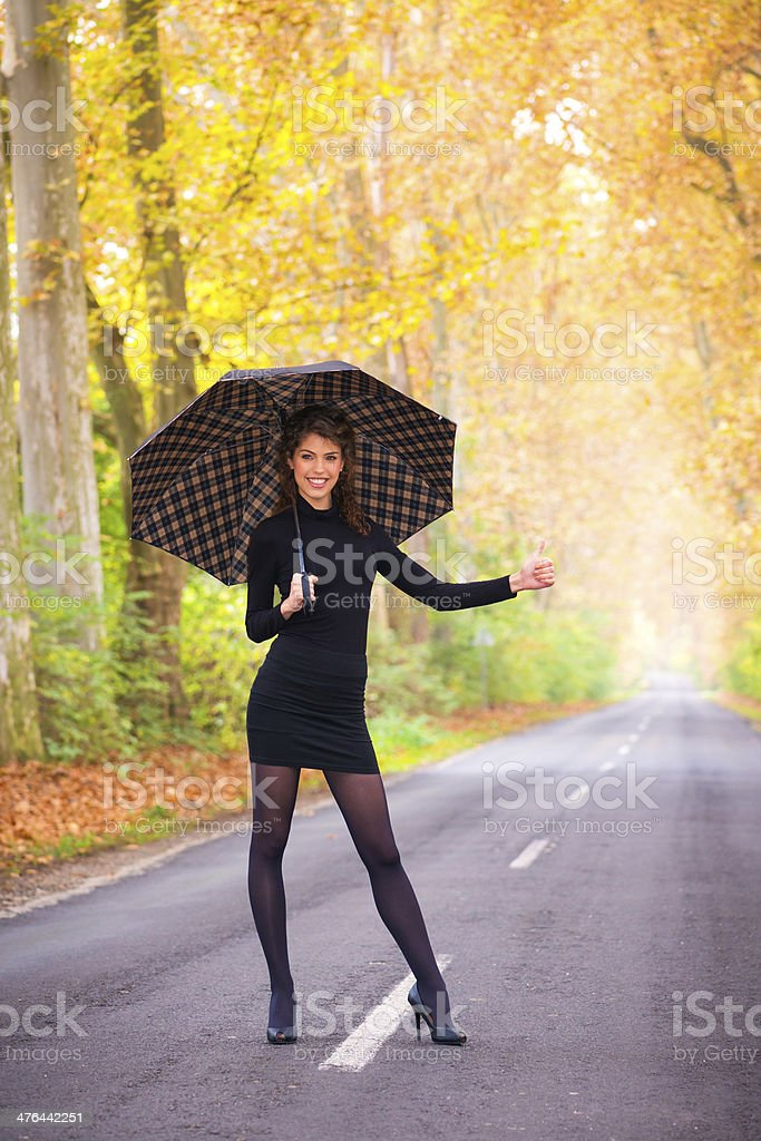 Young woman standing on the road royalty-free stock photo
