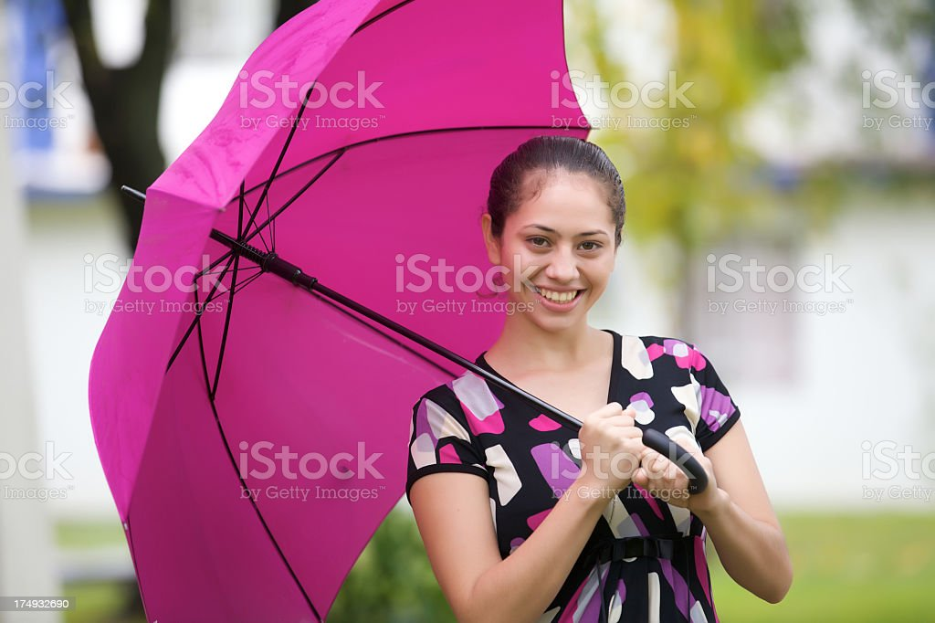 Young Woman Standing Under the Umbrella royalty-free stock photo