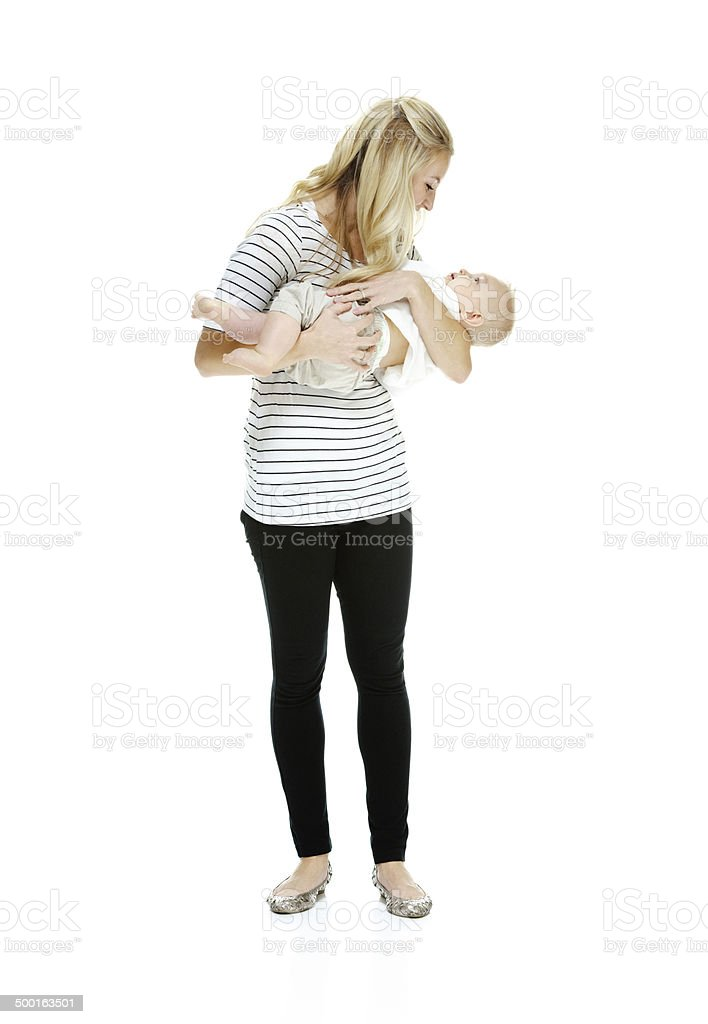 Young woman standing with her baby royalty-free stock photo