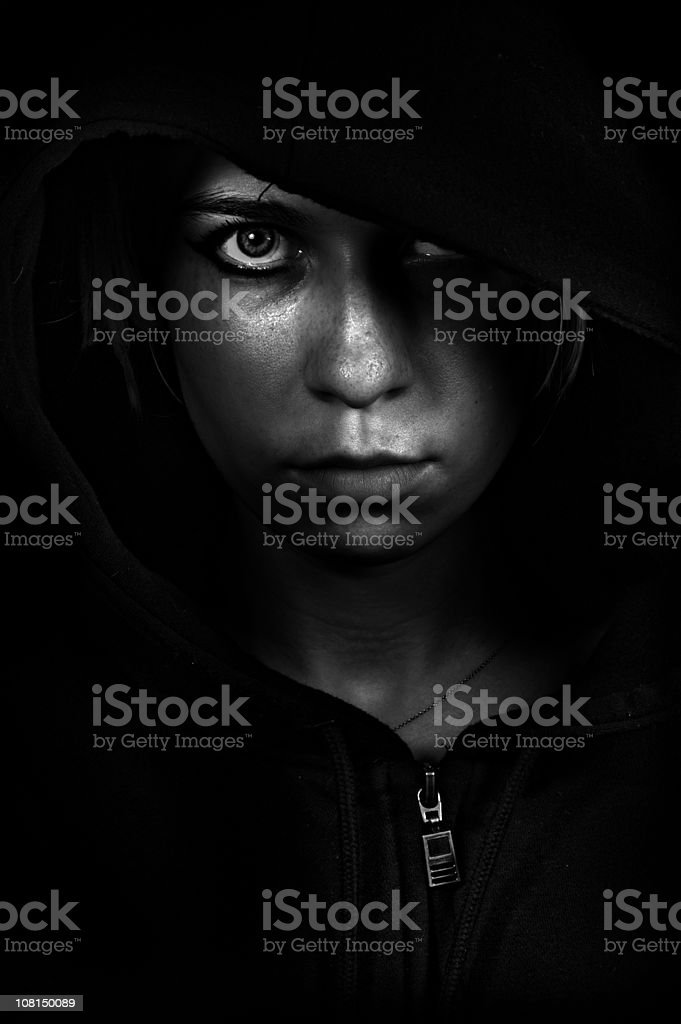 Young Woman Staring Ahead, Low Key Black and White stock photo
