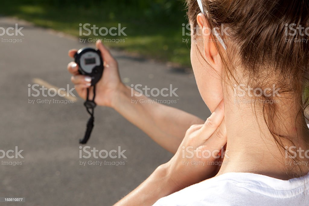 Young woman staring at a black stopwatch royalty-free stock photo