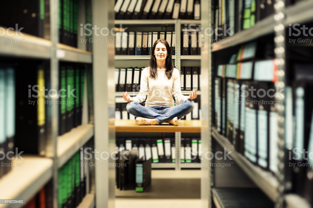 young woman staying calm amidst the chaos stock photo