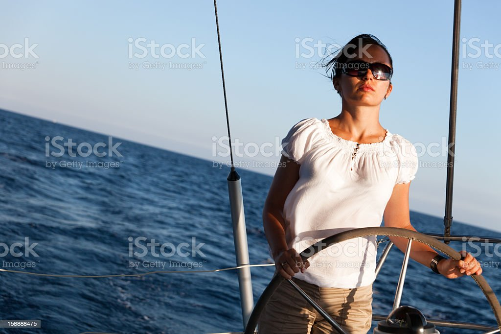 Young Woman Steering Yacht royalty-free stock photo