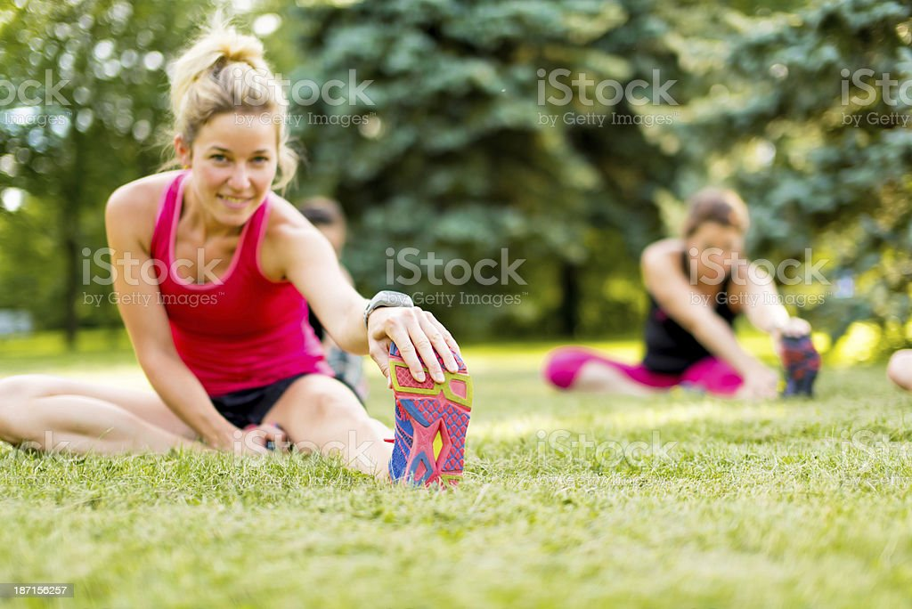 young woman stetching before a jog stock photo