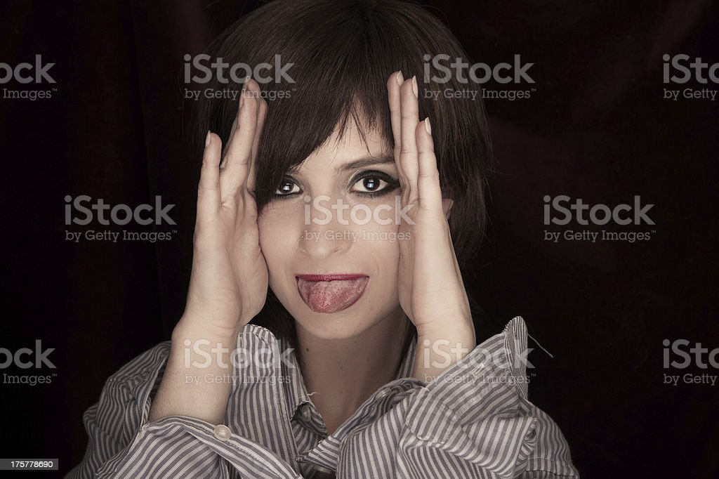 Young Woman Sticking toungue out at camera stock photo