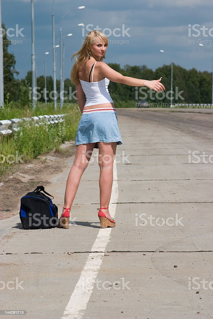 Young woman stopping a car. royalty-free stock photo
