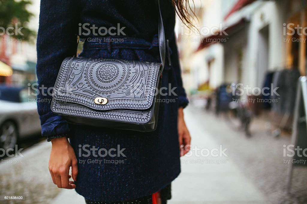 Young woman street style leather purse and a coat stock photo