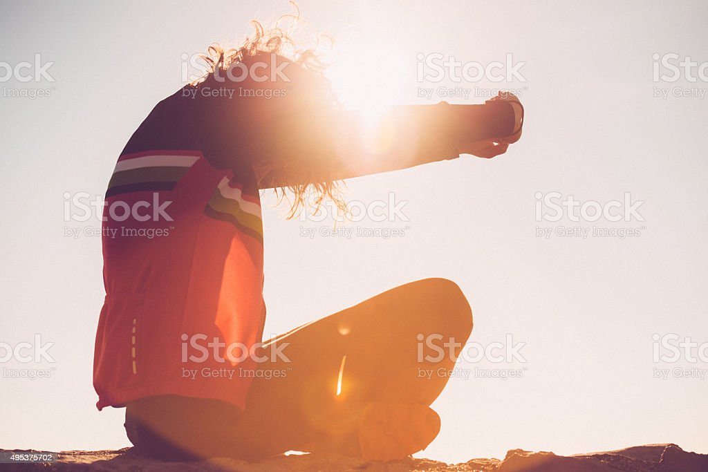 Young Woman Stretching After Running, Julian Alps, Europe stock photo