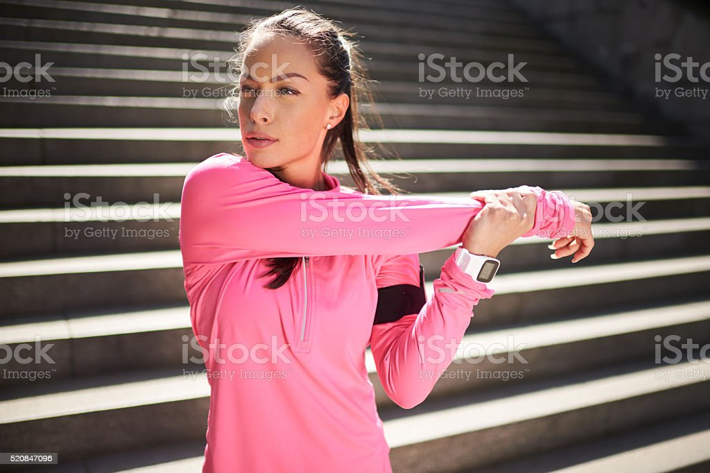 Young woman stretching and exercising stock photo