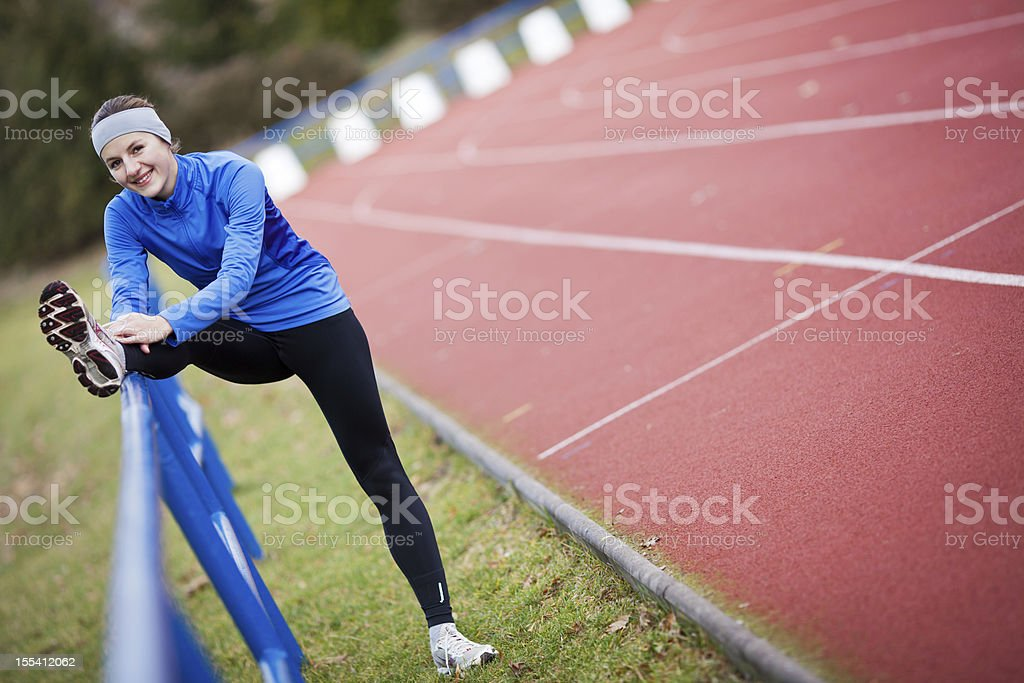 Young woman stretching before her run royalty-free stock photo