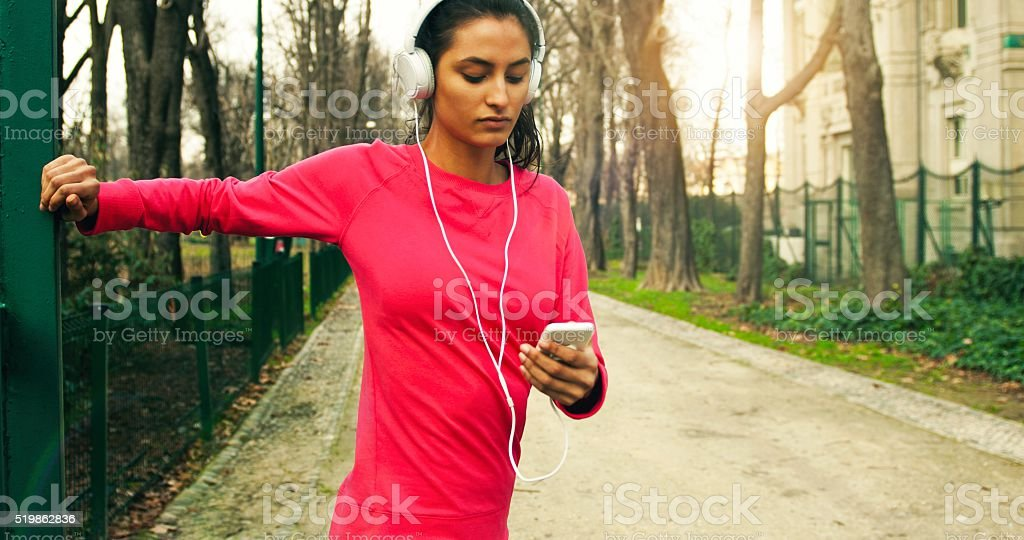 Young woman stretching before workout stock photo