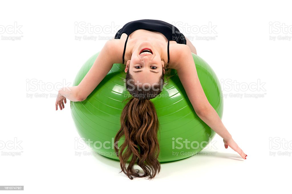 Young woman stretching her body on gymnastic ball royalty-free stock photo