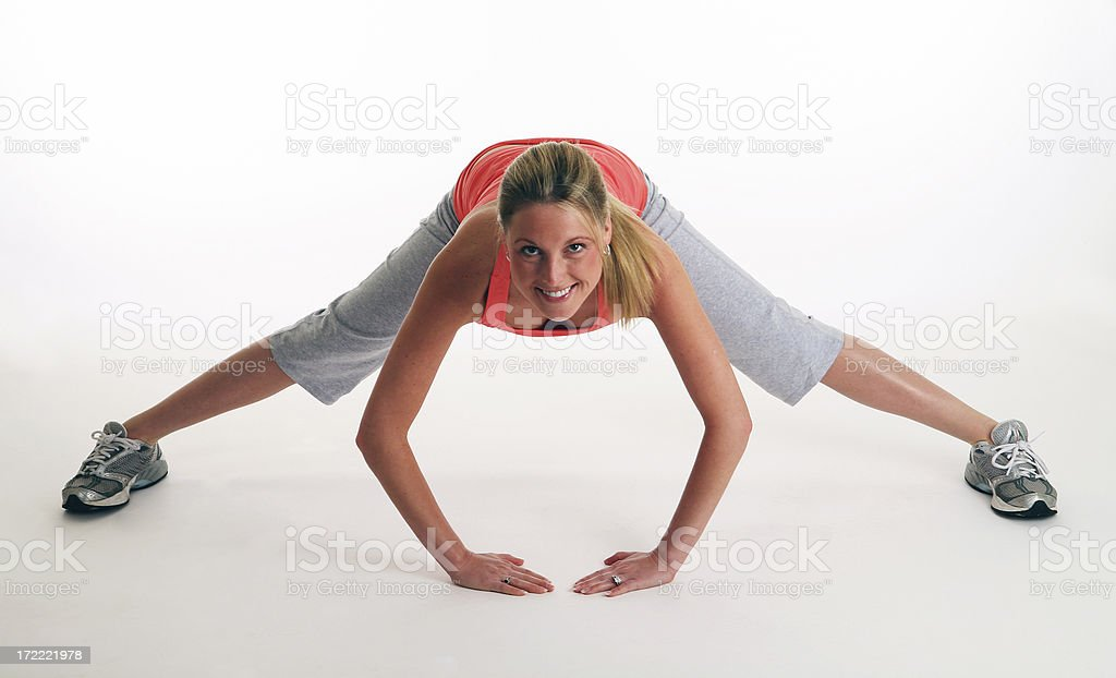 Young woman stretching her legs royalty-free stock photo