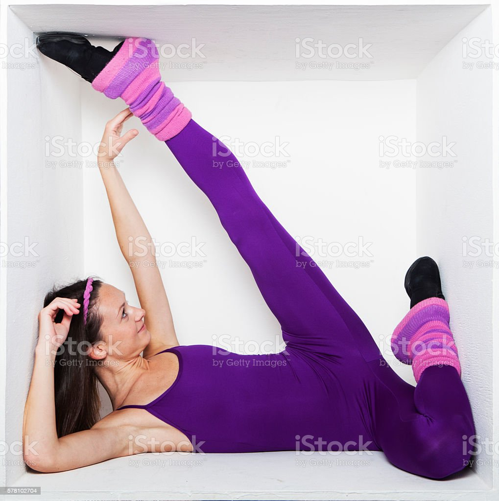 Young woman stretching in a box stock photo