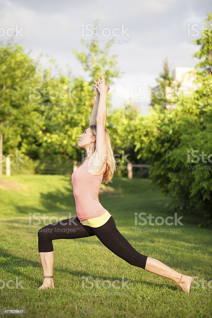 Young woman stretching in park royalty-free stock photo