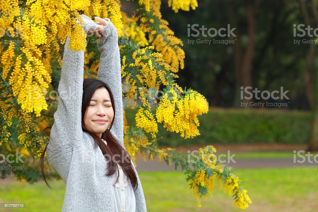 young woman stretching in park stock photo