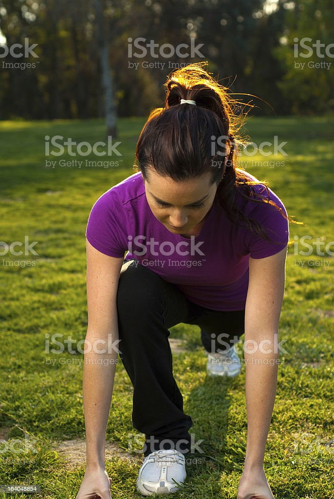 Young woman stretching in the park royalty-free stock photo