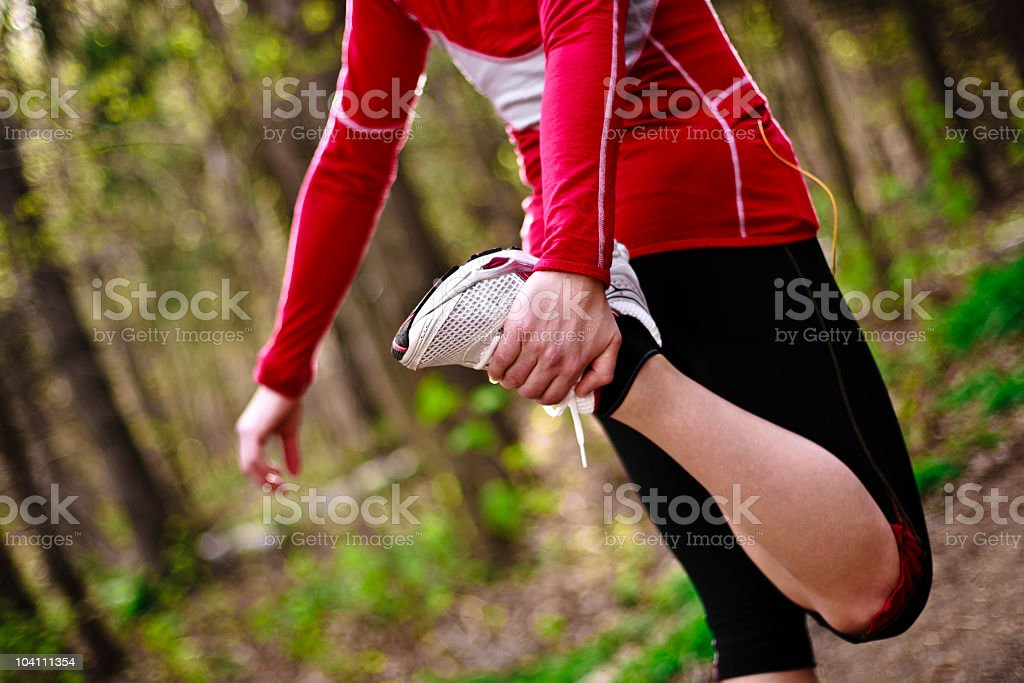 Young woman stretching, stock photo