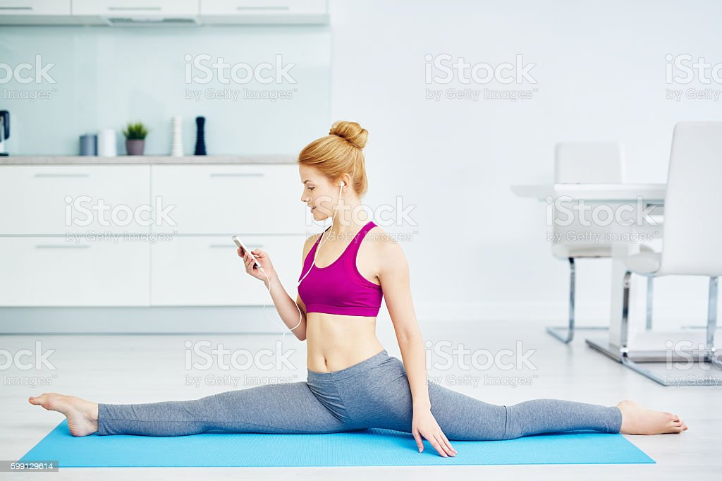 Young Woman Stretching stock photo