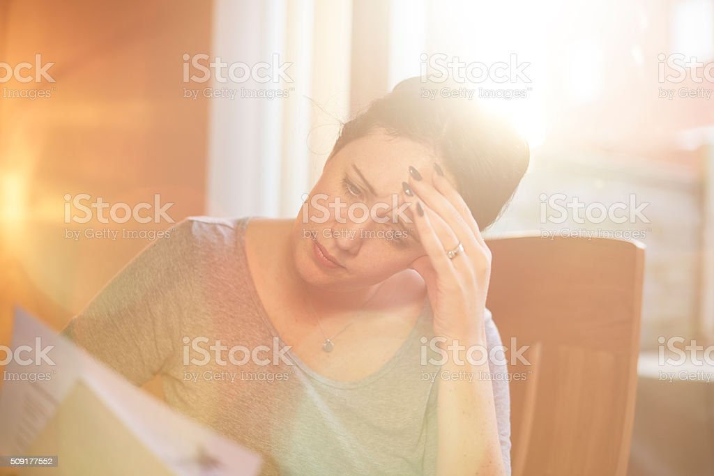 young woman struggling with the bills stock photo