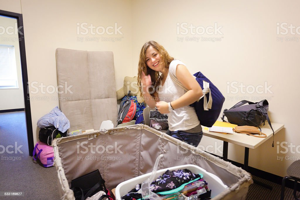Young Woman Student Moving Dormitory Room on University Campus stock photo