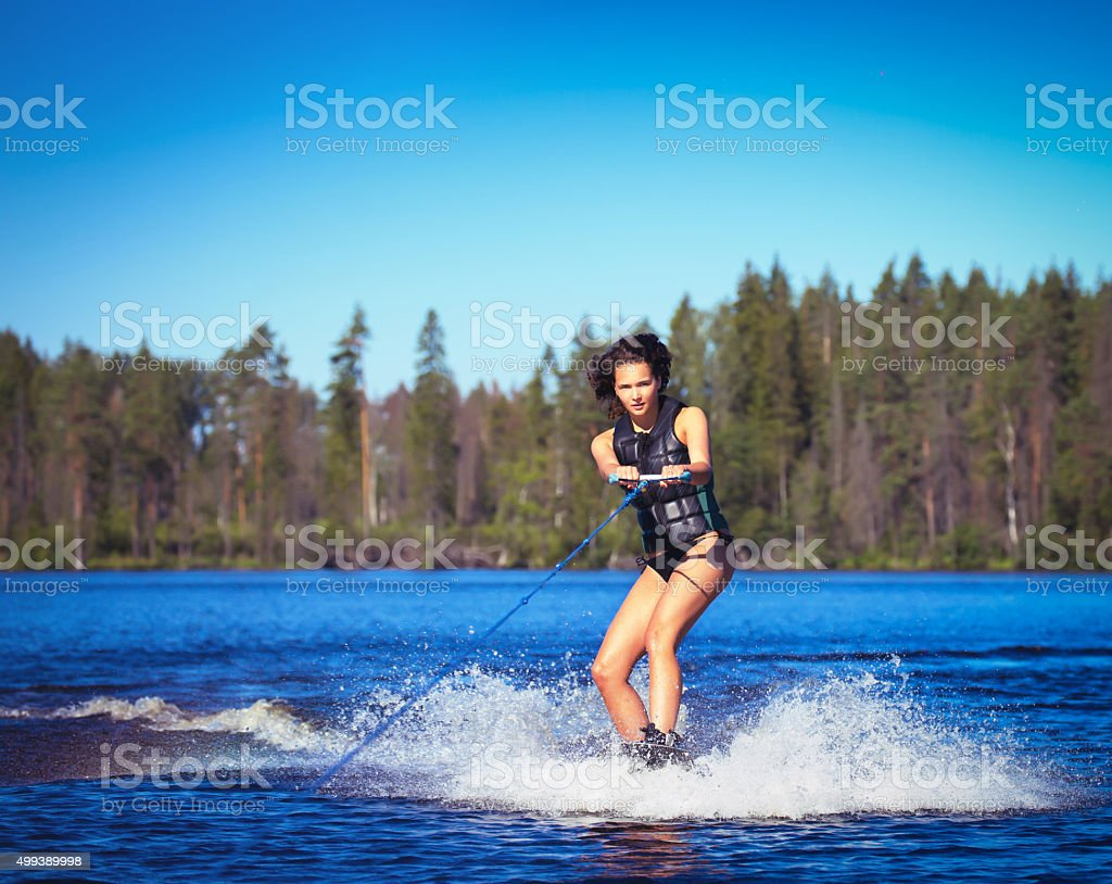 Young woman study riding wakeboarding on a lake stock photo
