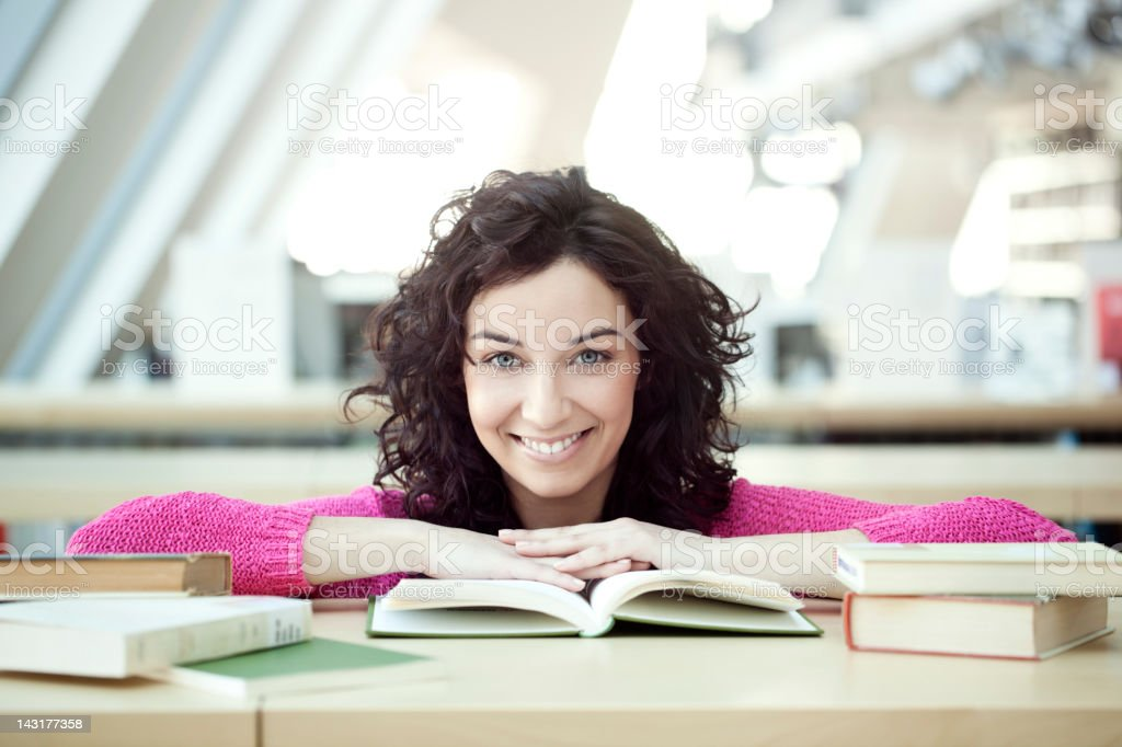 Young woman studying at the library royalty-free stock photo