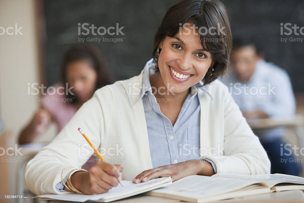 Young woman studying in classroom stock photo