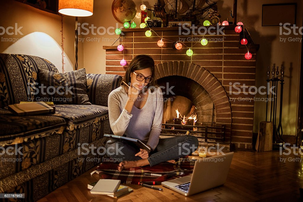 young woman studying in her cozy room stock photo