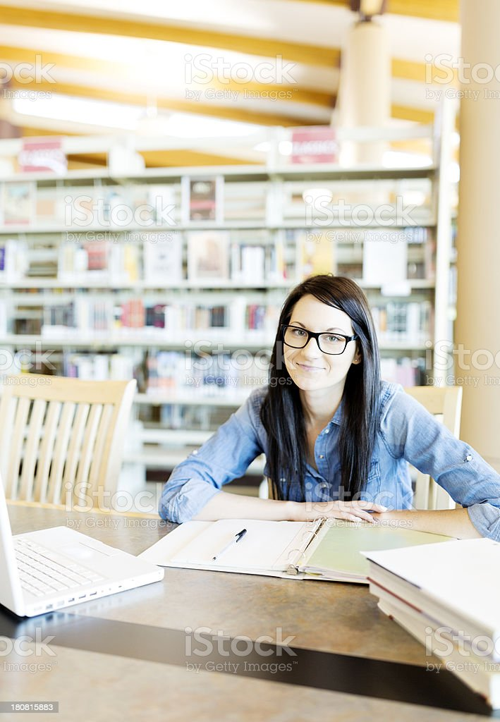 Young woman studying in library royalty-free stock photo