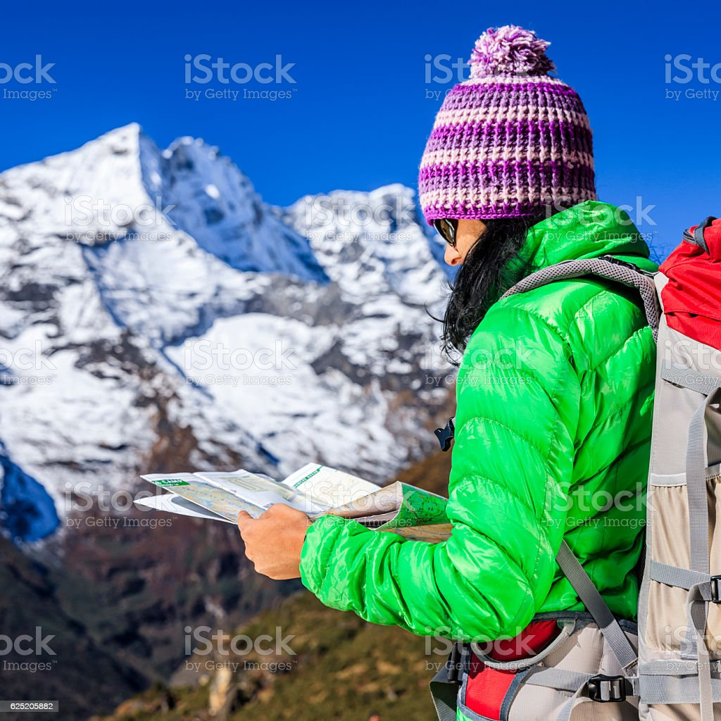 Young woman studying map in Himalayas, Mount Everest National Park stock photo