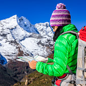 Young woman studying map in Himalayas, Mount Everest National Park