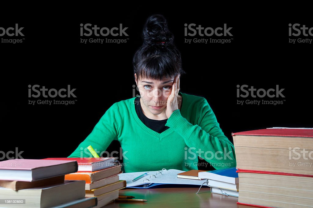 Young woman studying with a yellow marker stock photo