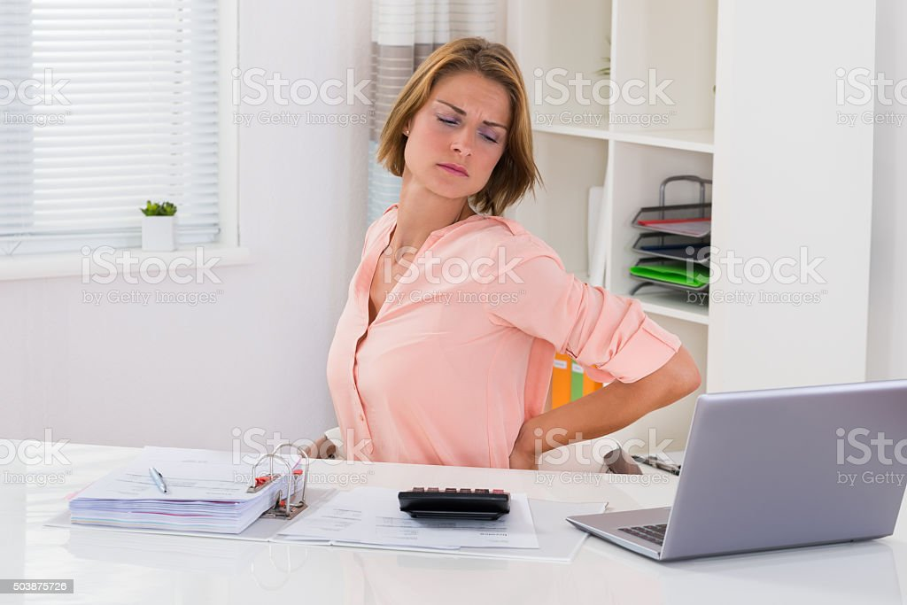 Young Woman Suffering From Backache stock photo