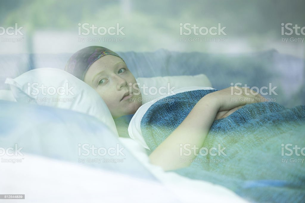 Young woman suffering from cancer stock photo