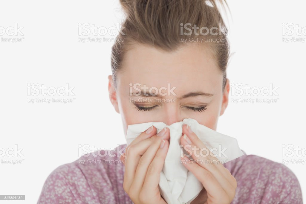 Young woman suffering from cold stock photo