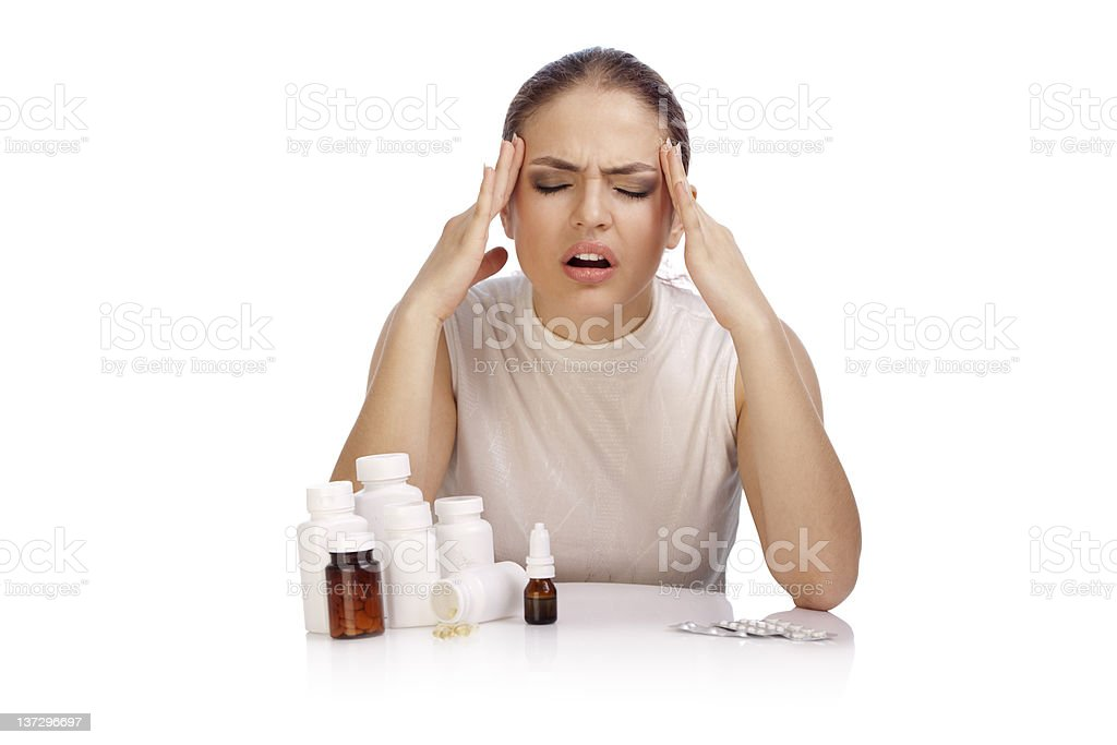 Young woman suffering from hard headache . XXXL royalty-free stock photo