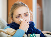 Young woman suffering of cold and having stuffy nose