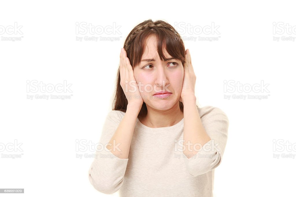 Young woman suffers from noise stock photo