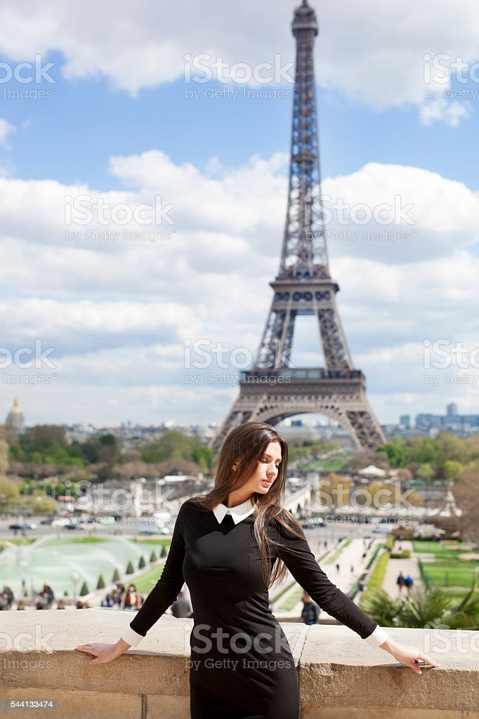 Young Woman Sunbathing and Relaxing Near The Eiffel Tower stock photo