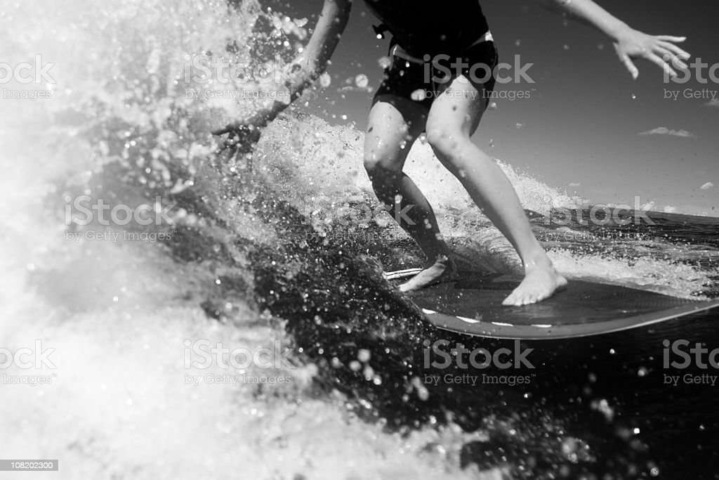 young woman surfing, black and white stock photo
