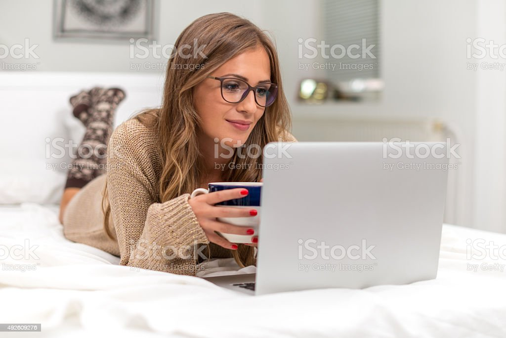 Young woman surfing the net stock photo