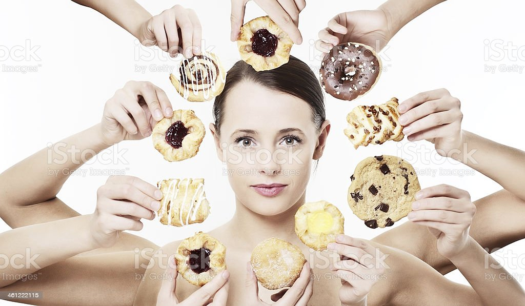 Young woman surrounded by hands offering her pastries stock photo