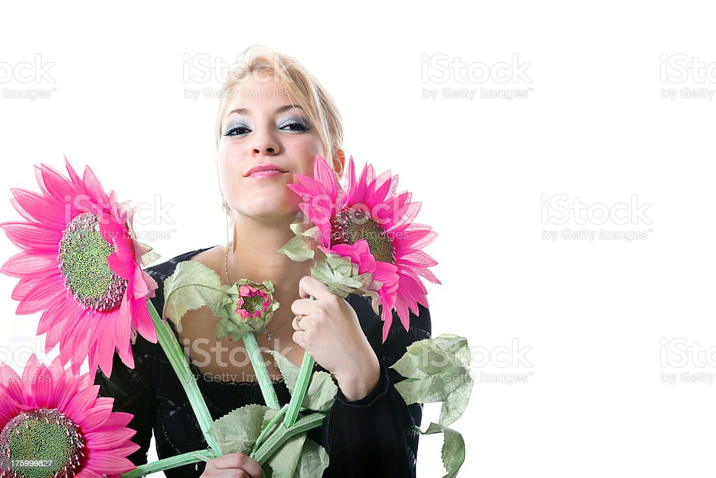 Young woman surrounding by flowers royalty-free stock photo