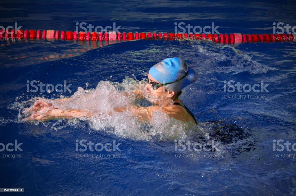 Young woman swimmer in swimming pool stock photo