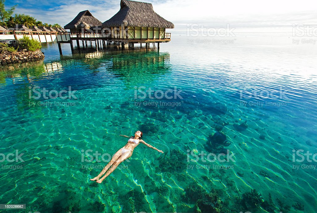 Young woman swimming in a coral lagoon stock photo