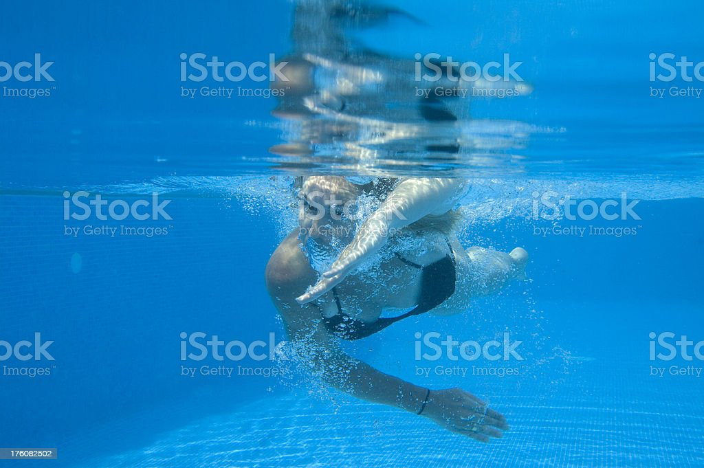 Young woman swimming in pool royalty-free stock photo