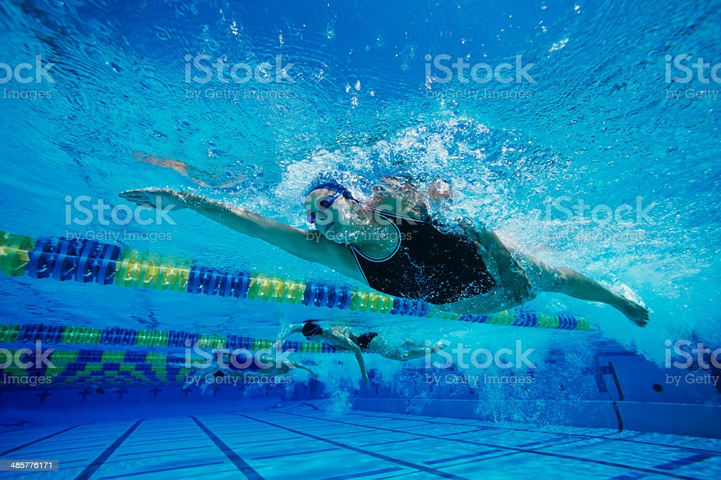 Young Woman Swimming in Pool stock photo