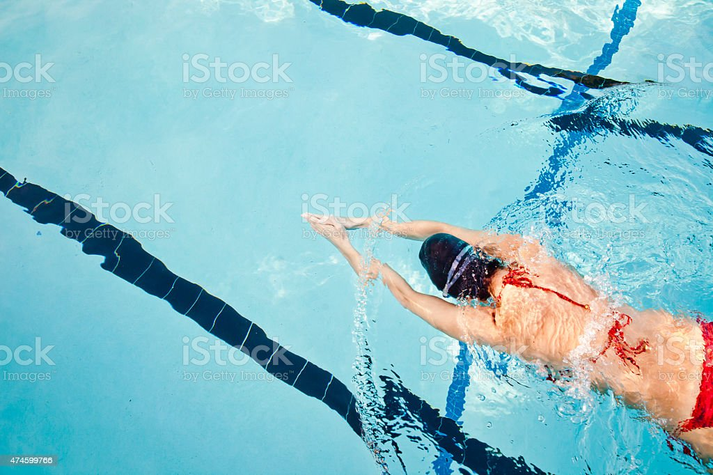 Young Woman Swimming Laps stock photo